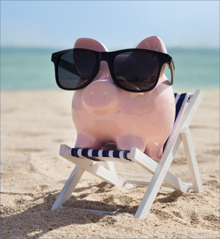 Piggy bank in chaise lounge at beach