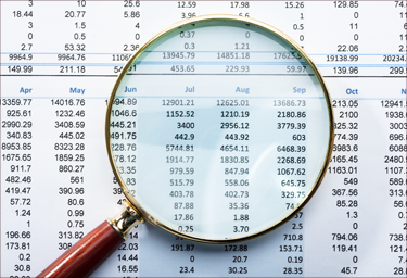 Magnifying glass over monthly numbers