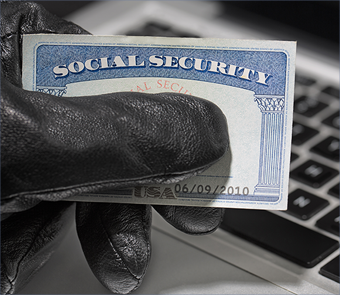 Gloved hand taking Social Security card